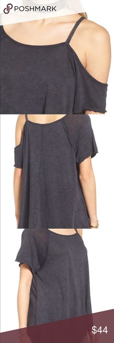 """Free People Coraline Tee Size Medium NWT Designed to gracefully slip off the shoulder, washed black color, high low detail, runs large. 22"""" to the shortest point, 26"""" to the longest point. 60% Cotton, 40% Modal Free People Tops Tees - Short Sleeve"""