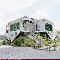 upside-down house, well technically it's right side up, it just LOOKS upside-down....someone has a sense of humor!