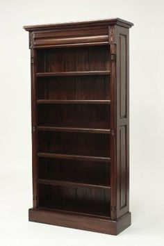 Tall Mahogany Bookshelf by Laurel Crown Furniture. $1485.00. Stately and practical, this Colonial mahogany bookcase provides a cluttered room with much-needed storage and antique style charm. This remarkable mahogany bookcase is a guaranteed head-turner, with its hand-carved edge details and warm, hand-rubbed finish. It also has a hidden top drawer to store your more valuable items. Give your favorite books, pictures, and knick-knacks a worthy showcase with thi...