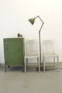 Dorset Finds Store — Pair of Emeco Aluminum 1006 Navy Chairs, Ajusco floor lamp, Lyon steel parts cabinet.