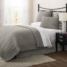 A predominate crinkle texture gives this Lush Decor bedding a unique design that will bring bold fashion to your bedroom decor. Clean and contemporary, this machine washable bedding comes in several soft hues.