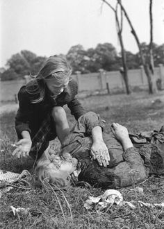 Ten-year-old Kazimiera Mika, shocked by the death of her sister, caused by strafing German aircraft near Warsaw, Poland, 13 Sep 1939. (My parents saw scenes like this when refugeeing out of wartorn China. The trauma of experiencing and witnessing such violence goes way beyond what we can learn from a single photograph).