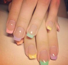 Neutral nails with soft pink, yellow and blue. All Spring colors
