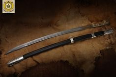 Caucasian cavalry sabre. Damascus steel blade and bronze hilt, decorated with inlaid gold and silver. - Album on Imgur