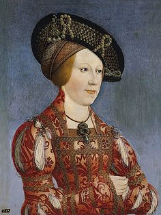 ca. 1520 Anne of Bohemia and Hungary by Hans Maler (Museo Thyssen-Bornemisza - Madrid Spain). Queen Anne's dress includes slashed sleeves, a jeweled bodice, jeweled sleeves, and a high collar. She wears a jeweled hat over one or two cauls.