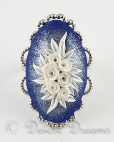 "- SOLD - $30.00 Flower Ring, Frozen Inspired, Roses Ring, Cocktail Ring, Polymer Clay Ring, Cameo Ring, Polymer Clay Flowers This beautiful statement ring is called ""Elsa's Coronation Bouquet"" and was inspired by the wonderful Disney movie Frozen!"