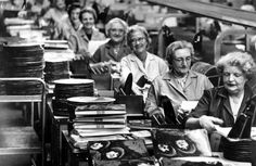 Ladies in a factory, putting together copies of The Beatles' 'Rubber Soul', 1965