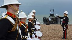 A band from the Royal Marines School of Music welcomes a team of Royal Marines as they arrive at Southsea - 6 June 2014