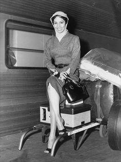 "Dorothy Dandridge arriving in New York to promote ""Carmen Jones"" in 1954. Photo by Paul Schumach."