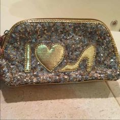 Sequin NINE WEST clutch Gently used for pens and pencils. No stains.   Tags: make up bag. Sparkly, Nine West, gold, silver, love, shoes, heels, pencil bag, cosmetic bag Nine West Bags Clutches & Wristlets