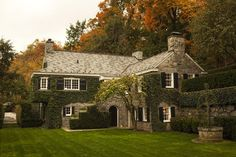 thefoodogatemyhomework:  Historic, grey stone home in Palisades, New York, overlooking the west bank of the Hudson River. The ivy and black ...