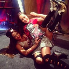 Backstage Photo of The Bella Twins Celebrating at WWE TLC ❤ liked on Polyvore featuring wwe and the bella twins
