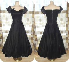 """early 1980's cocktail dress made by """"Moda, International"""". It is made of sinfully soft black rayon velvet and black satin acetate ruffles. It has an exquisite boned sweetheart bodice with boned cap sleeves covered in satin rumba ruffles and bow tie accents. It features a V waistline, stretch smocked back and a full tea length sweep. The bodice is lined and the boning runs along the formed bust."""