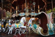 old carousel horses at the amusement park going around in circles in Paris, France