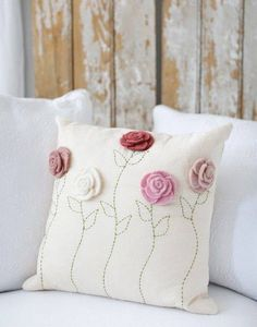 Sewing Pillows - Description - Artisan - Artisan Photo - Hang Tag Felt roses blossom atop a linen pillowcase that's finished with hand-embroidered stems. * Hand wash * Approximately x * Design on Front * Pil - Crochet Cushions, Sewing Pillows, Crochet Pillow, Diy Pillows, Decorative Pillows, Throw Pillows, Pillow Ideas, Felt Roses, Felt Flowers