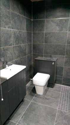Bathroom made with our #StoneboxAntracita series in a 32x62cm tile format. #HappyCustomers