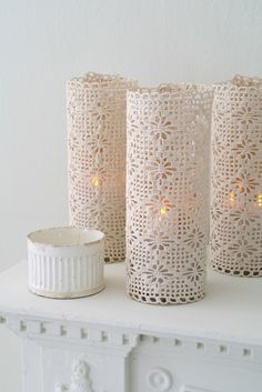 Pillar candles dressed up with humble placemats. Simply wrap around candles, & close the seam with some natural jute twine interwoven in the lace pattern & tie with a knot / Matthew Mead
