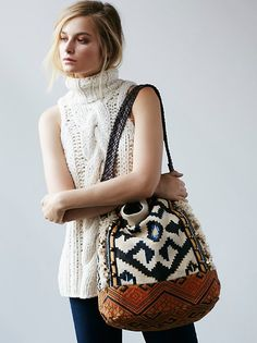 Indian Summer Hobo | Colorfully woven and embroidered hobo bag with studded leather handle. Folder zipper closure at the top. Zipper compartment on the front. Inside is fully lined with two pouches. *By Free People