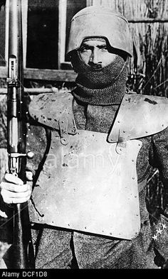 Italian soldier wearing body armour and helmet, WWI