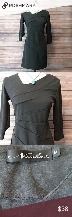 "Dress LOVE this dress! Charcoal grey slip on dress with an uneven V neckline that adds uniqueness. There are also ""pleats"" down the front. You want this dress in your wardrobe!! Necklace is also for sale. Neesha  Dresses Asymmetrical"