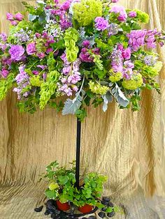 purple and green garden topiary centerpiece