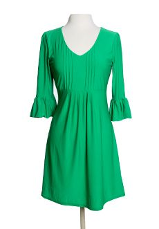 """Homecoming Trunk Shows - Were smitten with this dress that combines feminine flair and gorgeous bold color that is oh so comfortable.  Luxe fabric blend with just the right amount of stretch makes it absolutely flattering.     Approx length from shoulder to hem: 39""""  Poly/Elastane Blend  US Designed/Imported  Machine Wash/Hang Dry"""