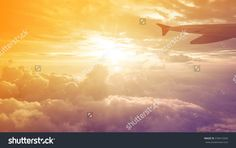 Airplane Wing in Flight from window over sunset sky  freedom fly travel