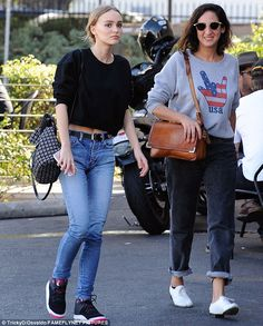Simple style: The teenage actres kept it simple with a black sweater and blue jeans