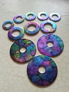 Washers stamped with alcohol ink.