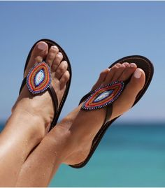 The Masai Leaf sandal is a tribal inspired design, the various colours will match your different outfits while keeping your feet stylish and comfortable.  Handmade in Kenya.  Thong style sandal.  Genuine leather upper (dyed & sun dried) with contrasting white stitching.  Flat flexible rubber sole (0.4'').