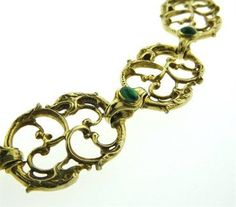 """An 18k yellow gold necklace set with emerald cabochons and diamonds by Paul Lantuch.    DESIGNER: Paul Lantuch  MATERIAL: 18K Gold  GEMSTONE: Diamond, Emerald  DIMENSIONS: The necklace is 17"""" long and 20mm wide  WEIGHT: 122.3 grams  MARKED/TESTED: Ad 1999, Lantuch, 750  CONDITION: Estate  PRODUCT ID: 16754"""