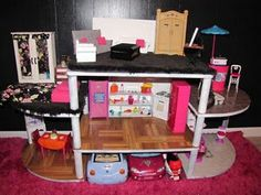 Now this is a Barbie dream house - cheaper and sturdier as well as a great project to do together. When Monkey is a little older this is a must-do project.