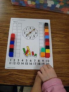 This is one of a number of games from the Bridges curriculum. You can download the file that describes the K work station activities. You will need to create your own boards if you don't own this curriculum. Link at:  https://www.mathlearningcenter.org/media/Bridges_GrK-2_WrkPlce_Direction/Bridges_GrK_WP_Directions.pdf