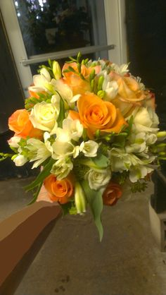 Bright orange and summery pastels in this wedding bouquet. Good Luck to the happy couple! americasflorist.com