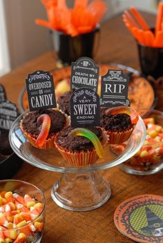 """Halloween graveyard cupcakes with gravestones saying """"Overdosed on Candy"""" and """"RIP"""""""