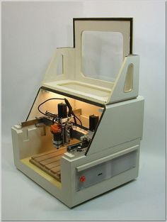 Momus CNC benchtop DIY router plans... The completed Momus CNC router is a fully enclosed and self-contained machine. There are no external boxes required for containment of electronic equipment, and the dust enclosure is integral to the machine design. The front half of the machine enclosure hinges upward, to allow unobstructed access to the bed area. #EbayWoodworkingMachines