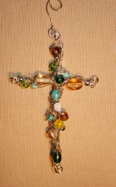 Wire wrapped beaded cross by BlueFlowerBoutique on Etsy, $12.00