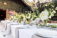 baby shower decorations at the lodge at torrey pines with white and green flowers and grey linens