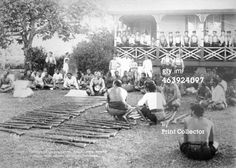Tamasese distributing arms, Apia, Samoa, 1899. Samoan Civil War 1898-1899. A view showing Tamasese sitting on the ground, with rifles in front of him, and people sitting around. British sailors stand on the verandah of the building in the background. (Photo by Art Media/Print Collector/Getty Images)