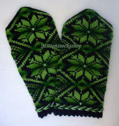 Hand knitted wool mittens Winter gloves Green star ornament on a black background Warm colorful elegant stylish latvian mittens Green black