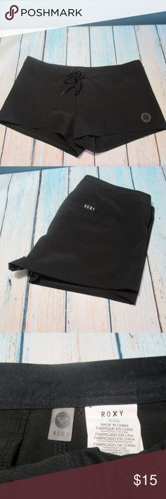 """Roxy Black Women's Boardshorts Size L Very nice condition Roxy black board shorts for women. Velcro and tie front closure. One small rear velcro pocket. Not lined. Size L. 92% polyester 8% spandex.   Approx measurements:  Waist 17"""" * Rise 9"""" * Inseam 2""""  Lightly worn condition. No snags.   Please check measurements on these shorts. The interior sizing tag is missing.   SW390326 Roxy Swim"""