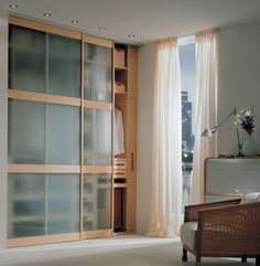 Hang full length curtains to separate the bathroom from the bedroom