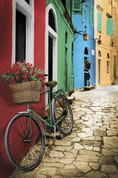 European bright colorful buildings and lovely stone path (street).. bicycle.