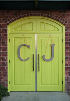 """For this wedding, the bride and groom's initials graced the entry door. We love the color. Get a similar door color with Behr's """"Crisp Green"""" paint."""