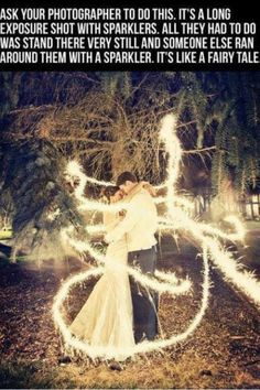 Have your photographer take this shot. What you do is stand very very still in the pose you want with your spouse, as a friend runs around you with a sparkler. I believe it's called an extended long shot. The end result is this. It looks like a fairytale!!