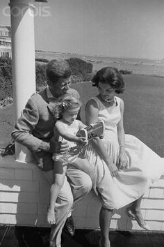 During a last weekend together before he hits the Presidential campaign trail, Senator John Kennedy and his wife Jacqueline spend time together at their Cape Cod resort with daughter Caroline. The port shows in background. August 28, 1960