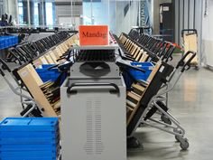This is one arm of the sorter at Aarhus Library.  All of the sort destinations have a ready-to-shelve cart. As they fill up, the carts can be taken directly out to the library for shelving.  There are 25 sort destinations with these carts.  The other arm has another 25 sort destinations for totes.