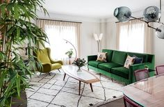 @brightbazaar recently added to his #hometour collection this eclectic colourful & #retorapartment in #centralLondon. The fantastic #greenfabric on this 2 seater #sofa brings this #livingroom alive! We are heads over heels on this #interiordesign by @kitesgrove! What part of this #interior would you love to add in your space?  #interiordesign #roominspiration #modernhome #apartmentdecor #design #interiorstyling #greensofa #retrolivingroom #plants #brightbazzar #kitesgroveproject