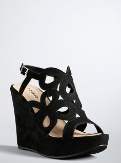 "<p>Bare your soles (and your pedicure while you're at it). A sky-high wedge that's actually comfy (blame it on the manageable platform) is sumptuous and sexy in black faux suede. A scalloped cage front and peep toe are begging to be shown off.</p>  <ul> 	<li>5"" wedge with 0.75"" platform</li> 	<li>Man-made materials</li> 	<li>Imported</li> </ul>"
