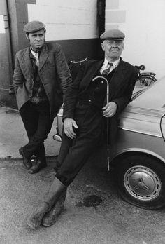 Two men pose for a photograph in Dowra, County Cavan, Ireland, circa 1974.